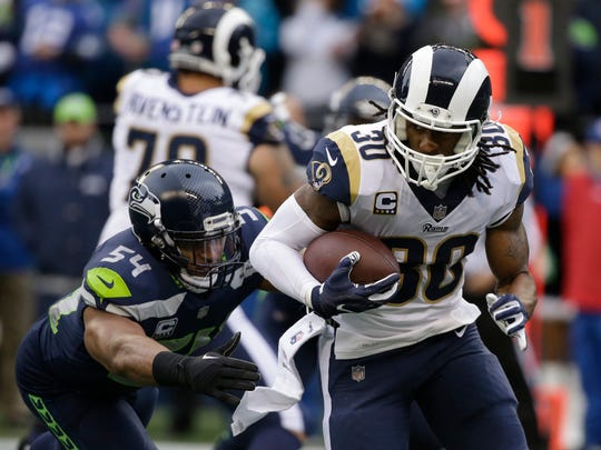 Seahawks linebacker Bobby Wagner, left, played through an injury during Sunday's blowout loss to the Los Angeles Rams. But he was ineffective against Rams running back Todd Gurley.