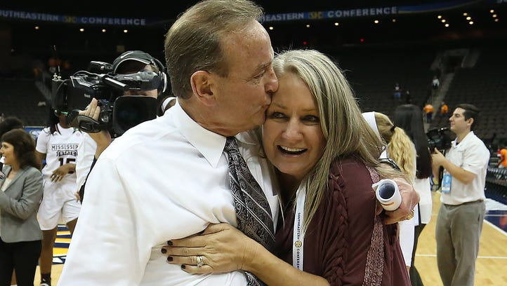 Vic Schaefer embraces his wife Holly Schaefer after a game against UT.