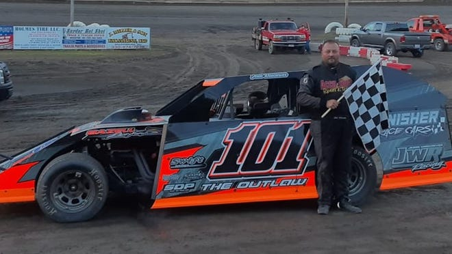Jesse Wisecarver holds the checkered flag after earning a win in July 10 at Hilltop Speedway.