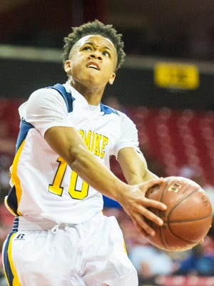 Pocomoke guard Tyler Nixon (10) takes a shot against Clear Spring in the 1A MPSSAA semifinals at the Xfinity Center in College Park on Friday, March 11.