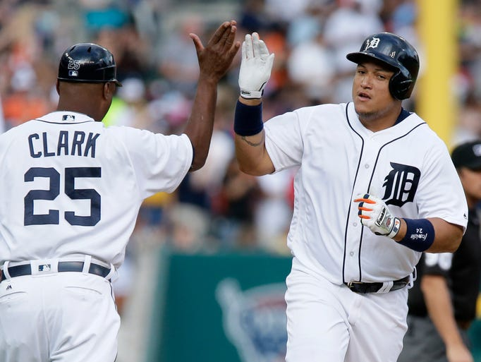 Miguel Cabrera of the Tigers is congratulated by third