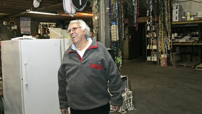 Lafayette businessman and philanthropist Don Stein stood in a Chestnut Street warehouse he turned into Surplus and Salvage, an ongoing garage sale that put proceeds to the Boys and Girls Club and the YWCA.