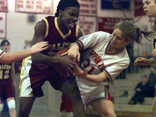 Albertus Magnus' Nydia Clayton battles with Tappan Zee's Stephanie Cleary. Jan. 19, 2000.