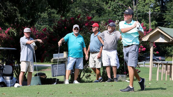Ashley Peterson, from left, James Leonard, Buddy Peters and Randy Shock watch Keith Jones' tee shot during a round of golf, Monday, September 7, at Deer Trails Golf Course at Chaffee Crossing.