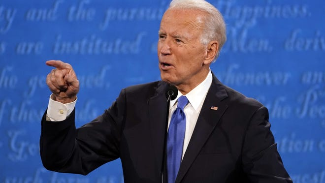 Democratic presidential candidate former Vice President Joe Biden speaks during the second and final presidential debate Thursday, Oct. 22, 2020, at Belmont University in Nashville, Tenn., with President Donald Trump.