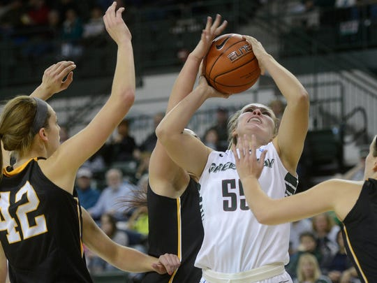 Green Bay PhoenixÕs Sam Terry takes a shot and draws a foul from Michigan Tech center Kylie Moxley in the second half. The Green Bay Phoenix defeated the Michigan Tech Huskies 74-50 at the Kress Events Center in Green Bay, Wis. on Saturday, Nov. 1, 2014.