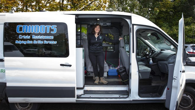 """CAHOOTS clinical coordinator Kate Gillespie stands in one of the vans used to respond to calls in Eugene. Gillespie has worked for the organization for nearly a decade. """"I've always been a helper,"""" Gillespie said. [Chris Pietsch/The Register-Guard file] - registerguard.com"""