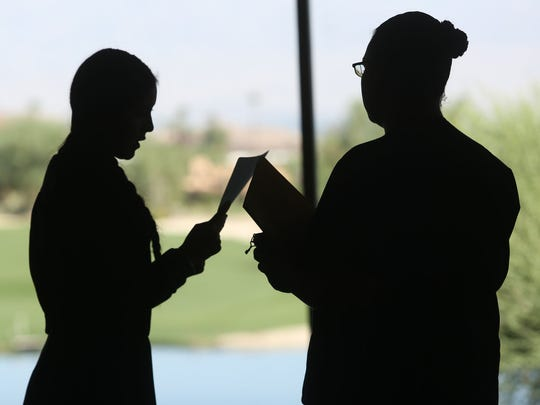 Bighorn Golf Club events coordinator Alix Miranda, at right, helps an applicant during a job fair at the club on Tuesday September 9 2014.