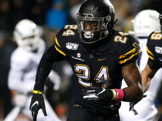Appalachian State linebacker Akeem Davis-Gaither (24) tracks the offense during the first half of the team's NCAA college football game against Georgia Southern on Thursday, Oct. 31, 2019, in Boone, N.C. (AP Photo/Brian Blanco)