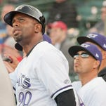 Louisville Bats manager Delino DeShields looks at a Toledo ball hit along the left-field line. 10 April 2015