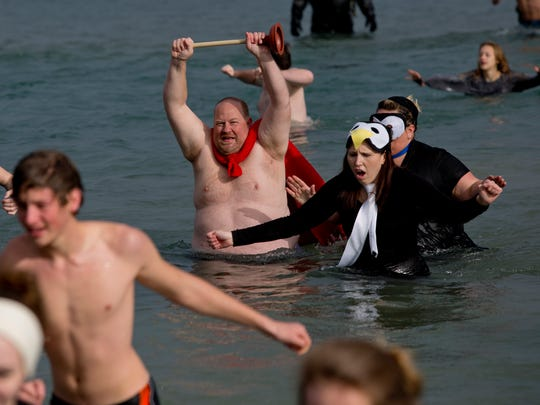Paul Miller of Fort Gratiot holds a plunger over his head while dressed as Captain Underpants during the Kiwanis Polar Bear Plunge Saturday, Dec. 5, 2015 at Fort Gratiot County Park.