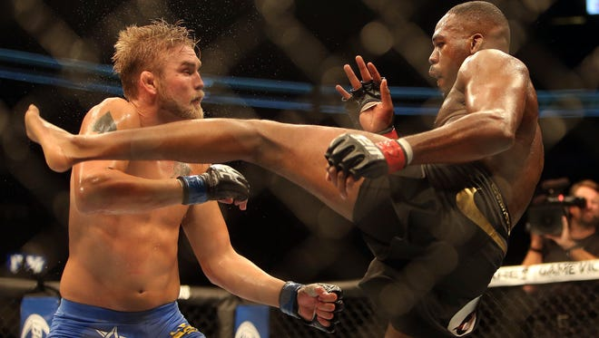 Jon Jones misses with a kick against Alexander Gustafsson during their Light Heavyweight Championship bout last September. Gustafsson  says he still thinks about his near upset that night
