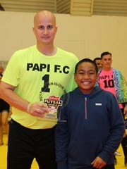 Papi FC's David Drews (No. 1), left, was presented
