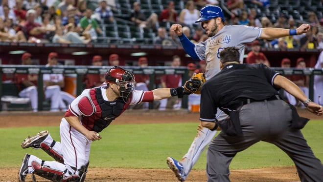 The Diamondbacks' Miguel Montero makes a tag on Royals' Mike Moustakas in the ninth inning at Chase Field on Thursday August 7, 2014.