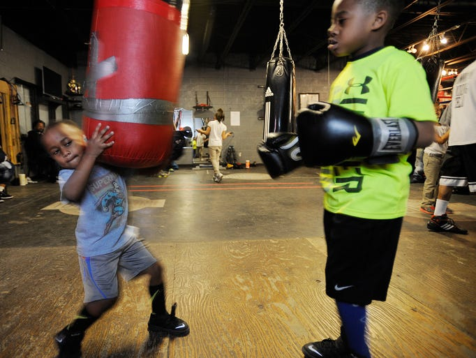 Raymond Trigg III, 4, helps out his brother, Amarion