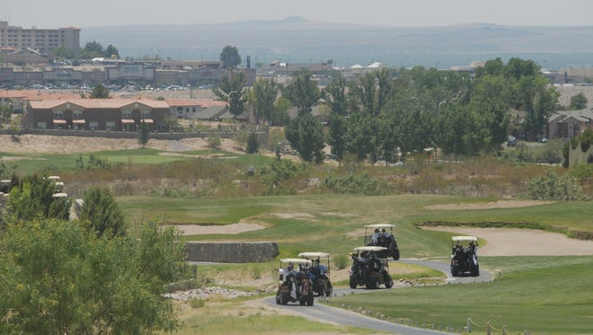 Golf carts travel through the Sonoma Ranch Golf Course during a 2011 tournament. After just over a year under Las Cruces Country Club control, the golf course will become a public golf course again.