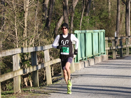 Justin Krebs of York won the Spartan Half Marathon on Sunday, crossing the line in 1:16:38.