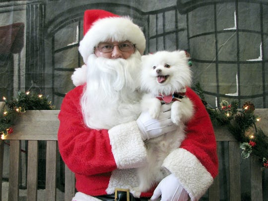 Yvette Martinez of York submitted this photo of her dog with Santa Claus at the York County SPCA.