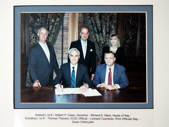 In this photo from Feb. 14, 1990, Gov. Robert P. Casey signs legislation that creates the criminal charge called assault on a sports official into law. Leonard Czarnecki, seen in the middle of the picture, who served as the Pennsylvania Interscholastic Athletic Association District III male officials' representative, helped push for the measure.