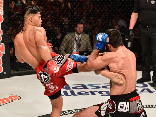 In this file photo from March 2016, Baby Joe the Juggernaut Taimanglo connects a kick to Sirwan Kakai's ribcage in Bellator 151. Taimanglo won by unanimous decision.