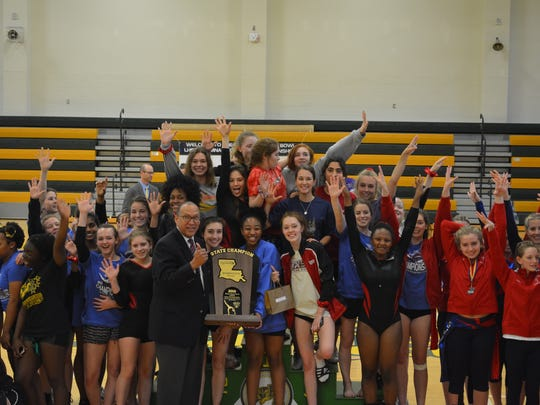 The Caddo Magnet girls gymnastics team won the 2018