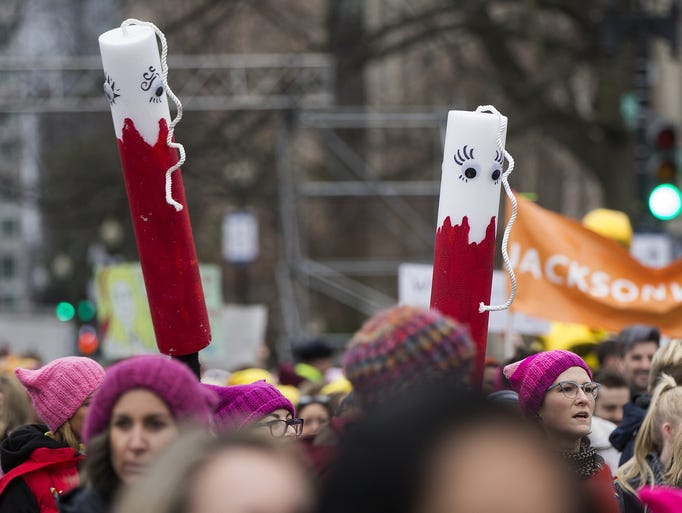 Image result for woman bloody tampon women's march