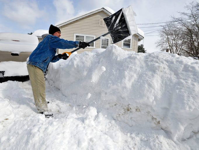 Allen Millette adds to the growing pile of snow in