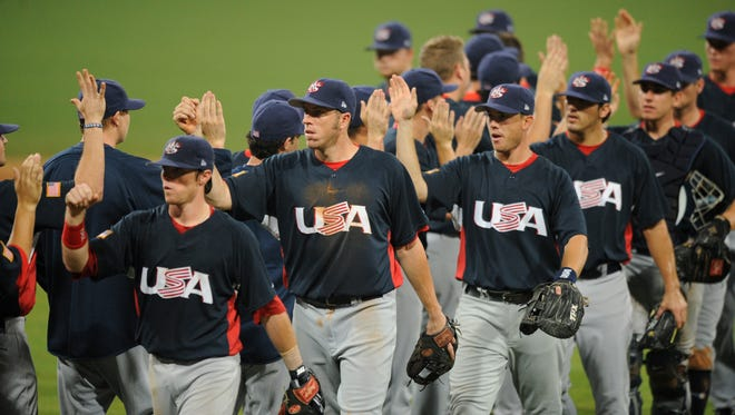 Team USA celebrates a victory over Japan at the 2008 Beijing Olympics.