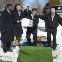 Jacob Washburn is handed the casket by Detective Steve Hinkley, left, and Undersheriff Tim Hurtt.