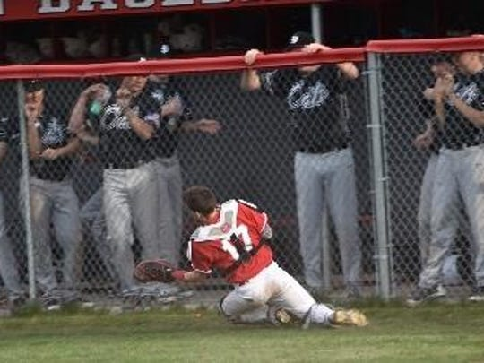 Sliding to catch a foul pop-up during Wednesday's second