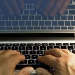 Companies including Google and the Huffington Post are trying everything from deploying moderators to forcing people to use their real names to restore civility in online comments.  AP FILE - In this Wednesday, Feb. 27, 2013 photo illustration, hands type on a computer keyboard in Los Angeles. Companies including Google and the Huffington Post are trying everything from deploying moderators to forcing people to use their real names in order to restore civil discourse on online comment threads. (AP Photo/Damian Dovarganes, File)