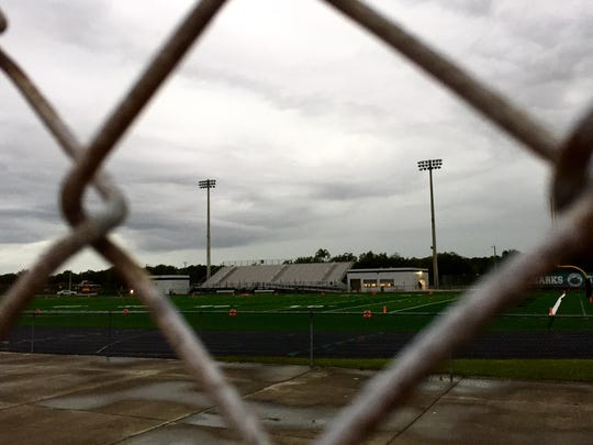 Gulf Coast High School's football stadium sits empty as lightning delays the football game against Lely High School in North Naples on Friday, Aug. 26, 2016. David Albers/Naples Daily News