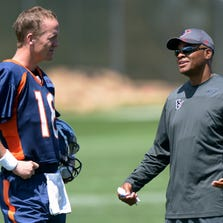 Aug 19, 2014; Englewood, CO, USA; Houston Texans general manager Rick Smith (right) talks with Denver Broncos quarterback Peyton Manning (18) during scrimmage at the Broncos Headquarters. Mandatory Credit: Kirby Lee-USA TODAY Sports