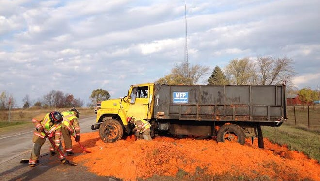 A Michigan Freeze Pack truck spilled its load of carrots on Oceana Drive Monday morning.