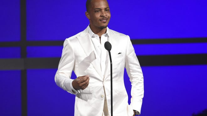 """FILE - This June 23, 2019 file photo shows Tip """"T.I."""" Harris at the BET Awards in Los Angeles. Planned Parenthood and others on social media blasted T.I. after the rapper said he goes to the gynecologist with his daughter every year to make sure her hymen is """"still intact."""" T.I. told the """"Ladies Like Us"""" podcast that he takes """"yearly trips to the gynecologist"""" with his now 18-year-old daughter, Deyjah Harris. Social media blew up afterward, with people strongly lashing out at T.I. (Photo by Chris Pizzello/Invision/AP, File)"""