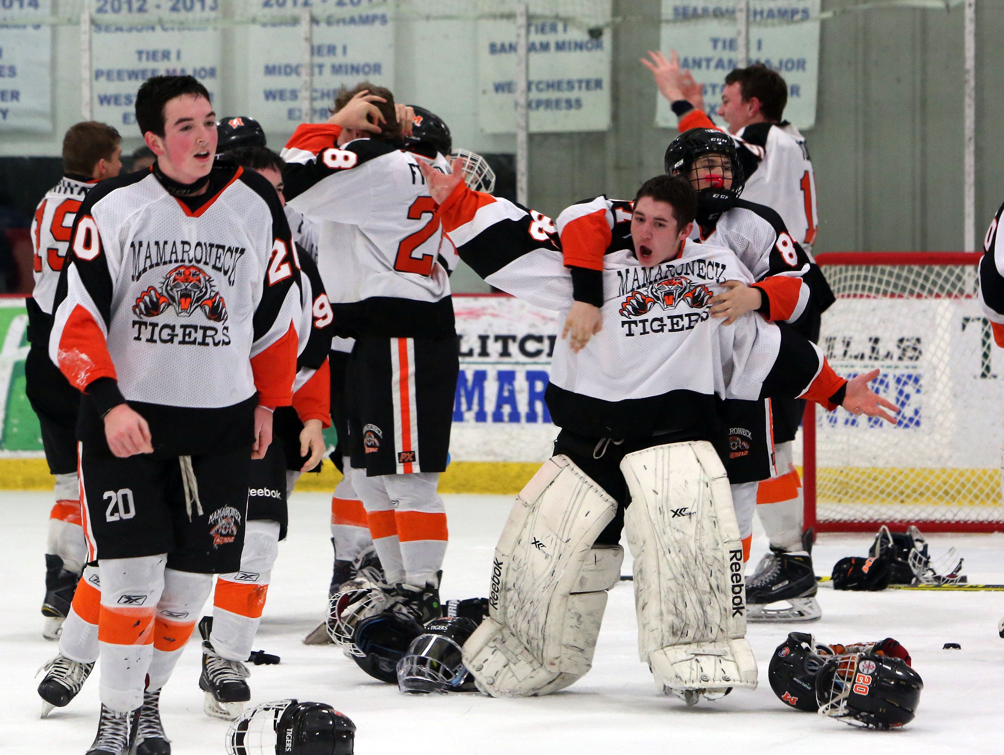 Mamaroneck players celebrate their 5-1 victory over Suffern to win the Section 1 championship hockey game at The Brewster Sports Arena Feb. 26, 2016.