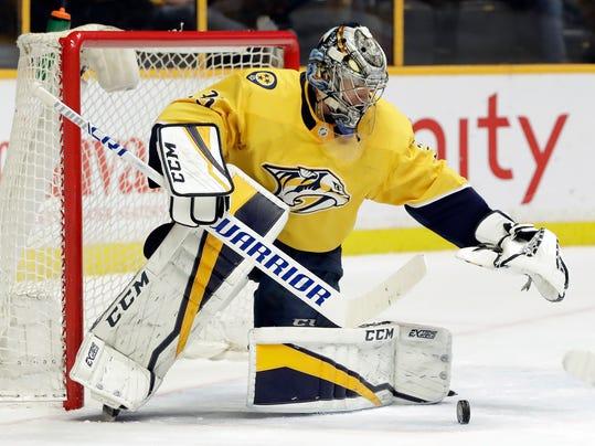Nashville Predators goalie Pekka Rinne, of Finland, blocks a shot against the Dallas Stars in the first period of an NHL hockey game Tuesday, March 6, 2018, in Nashville, Tenn. (AP Photo/Mark Humphrey)