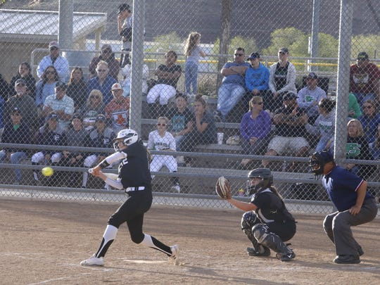 Piedra Vista's Cheyenne Stark hits an RBI single in the third inning against Farmington on Tuesday at the Farmington Sports Complex.
