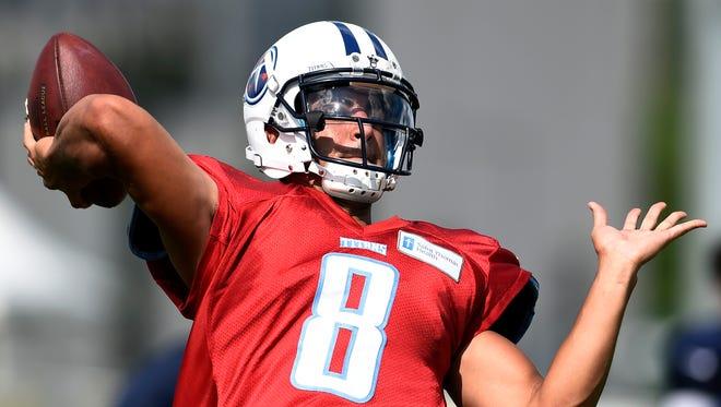 Titans quarterback Marcus Mariota (8) throws a pass during practice Tuesday.
