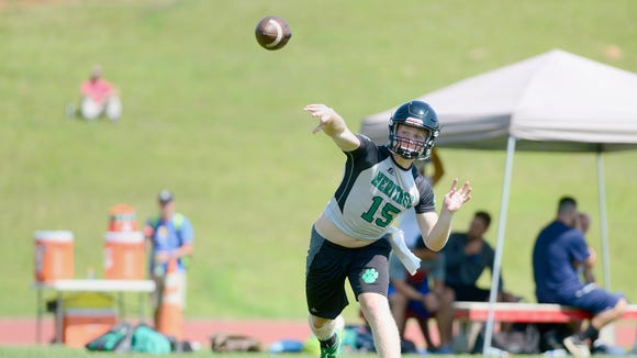 Mountain Heritage quarterback Trey Robinson throws a pass during the FCA annual 7-on-7 tournament at Erwin High School on Thursday, July 13, 2017.