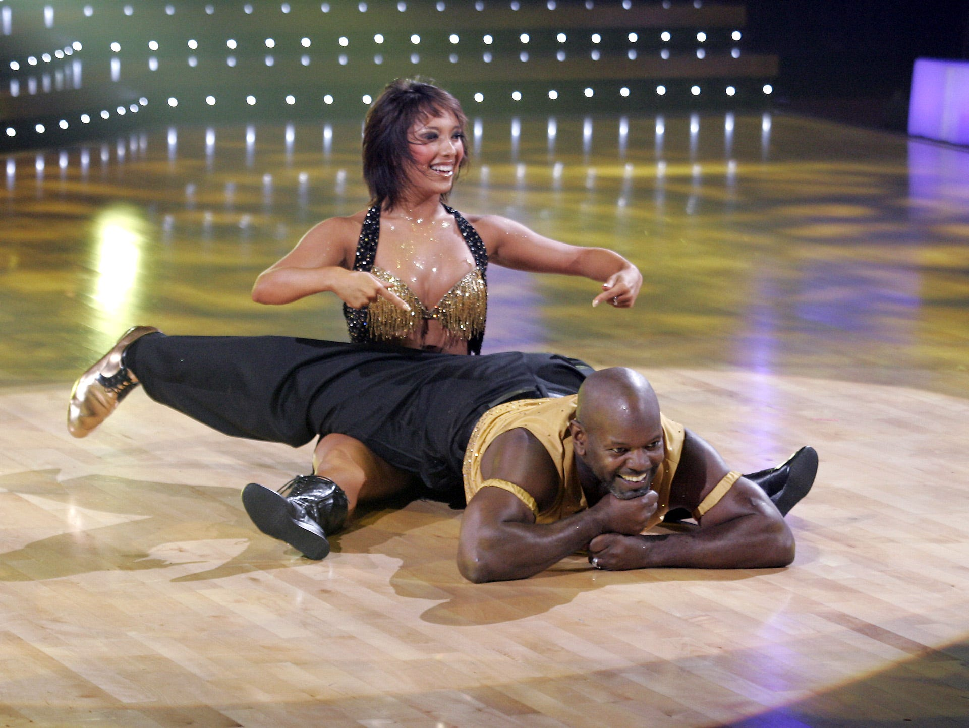 """Emmitt Smith dances with his partner Cheryle Burke as two teams remain vying for the chance to be crowned champion of """"Dancing with the Stars,"""" on Tuesday Nov. 14, 2006."""