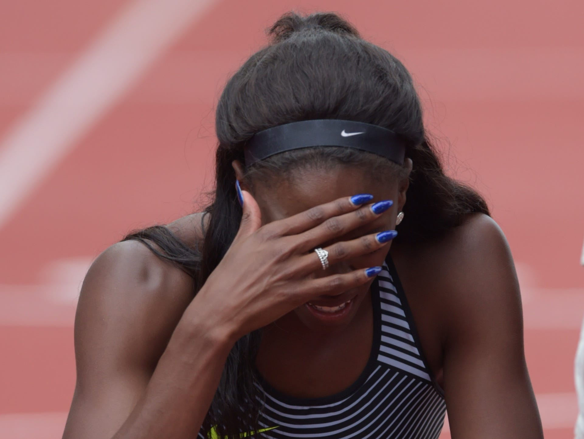 Ashley Spencer reacts after competing during the women's 400m hurdles finals in the 2016 U.S. Olympic track and field team trials at Hayward Field.