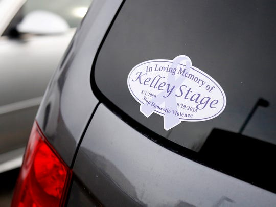 Several vehicles in the Steuben County courthouse parking lot have stickers displayed memorializing Kelley Stage Clayton, who was killed in Sept. 2015. Her husband, Thomas, is accused of hiring Michael Beard to carry out the murder.