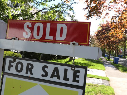 TY-051017-SOLD-FOR-SALE-SIGN-NEIGHBOR-wnton.jpg