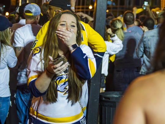 Samantha Liddell of Brentwood covers her mouth in shock  as the Nashville Predators beat the Ducks in the Stanley Cup Playoffs at the Bridgestone Arena in Nashville, Tenn., Monday, May 22, 2017.