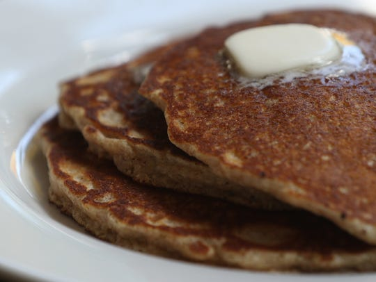 Whole-wheat pancakes with real maple syrup.
