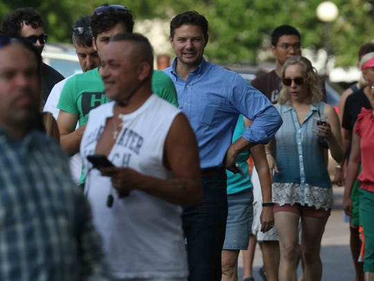 David Andreatta waits in line for a pair of eclipse