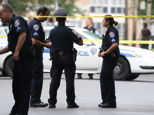 Police investigate a homicide in August 2016 in the Sherman Street area after a ShotSpotter alert and neighbors called 911.
