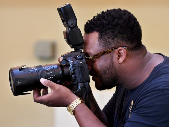 Darren Lykes, the official photographer for the Miss