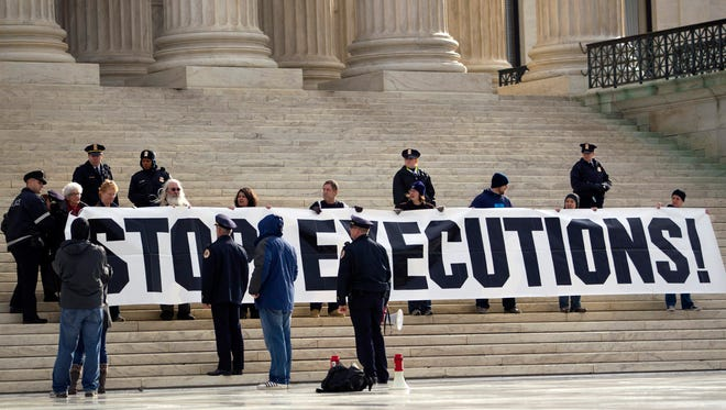 Demonstrators hold a banner on the steps of the Supreme Court three years ago during a protest against the death penalty.